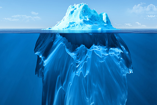 Iceberg above and below water line