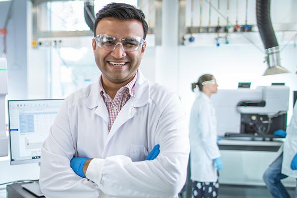 smiling chemist in lab