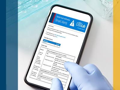 Gloved hand using Agilent CrossLab Smart Alerts on mobile device