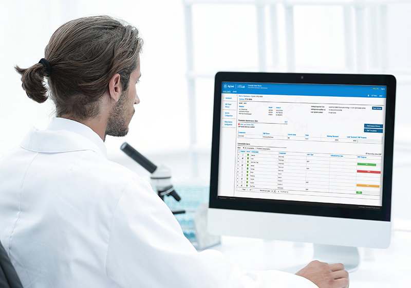 Lab scientist reading data on a computer monitor